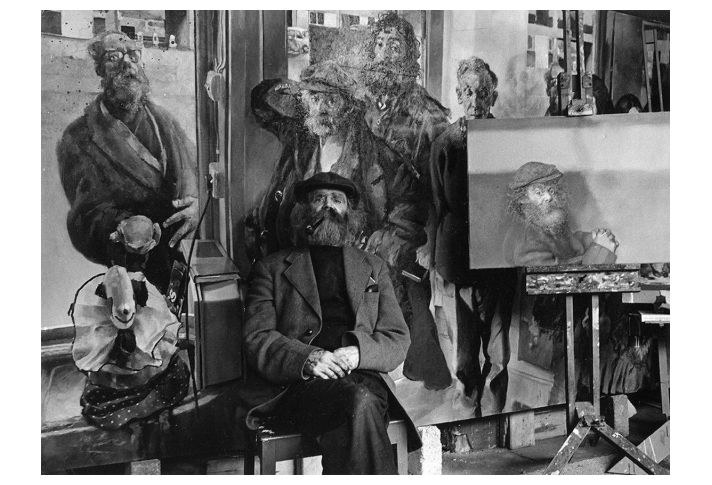 Diogenes seated with some of his portraits, 1974. (Photo: Ivor J. Hibbard)