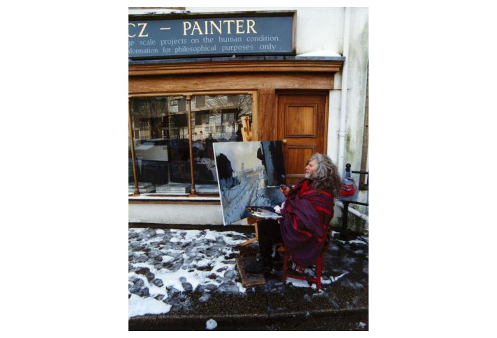 Robert painting outside his studio in the winter of 1995.