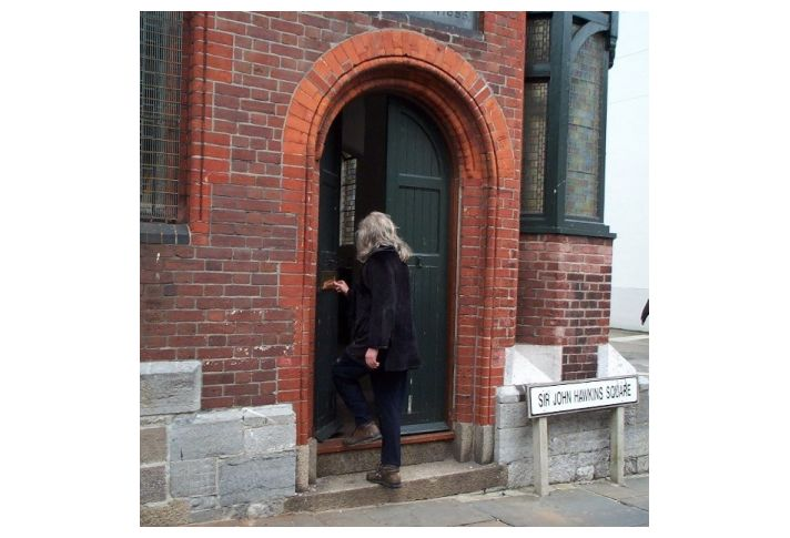 Robert entering The Mission Hall in Sir John Hawkins Square to view the works for the first time, 2000.